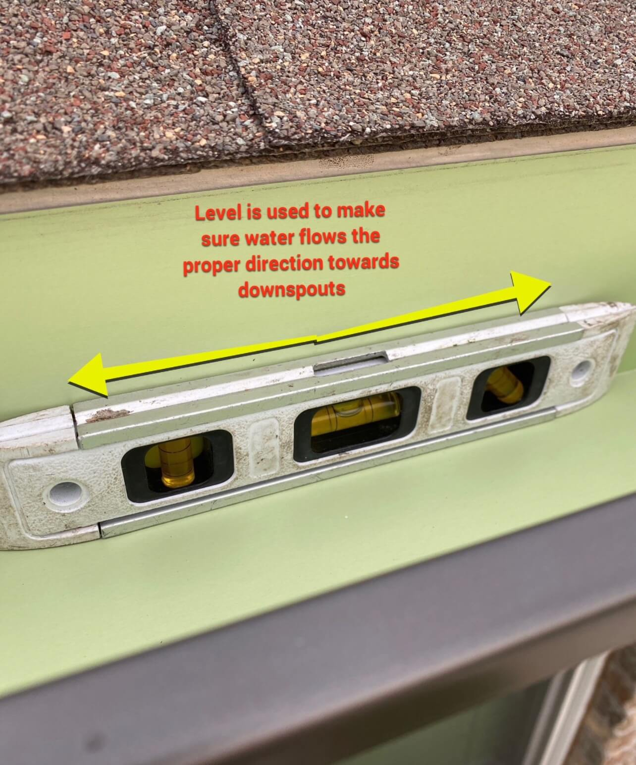 a level placed inside of a gutter